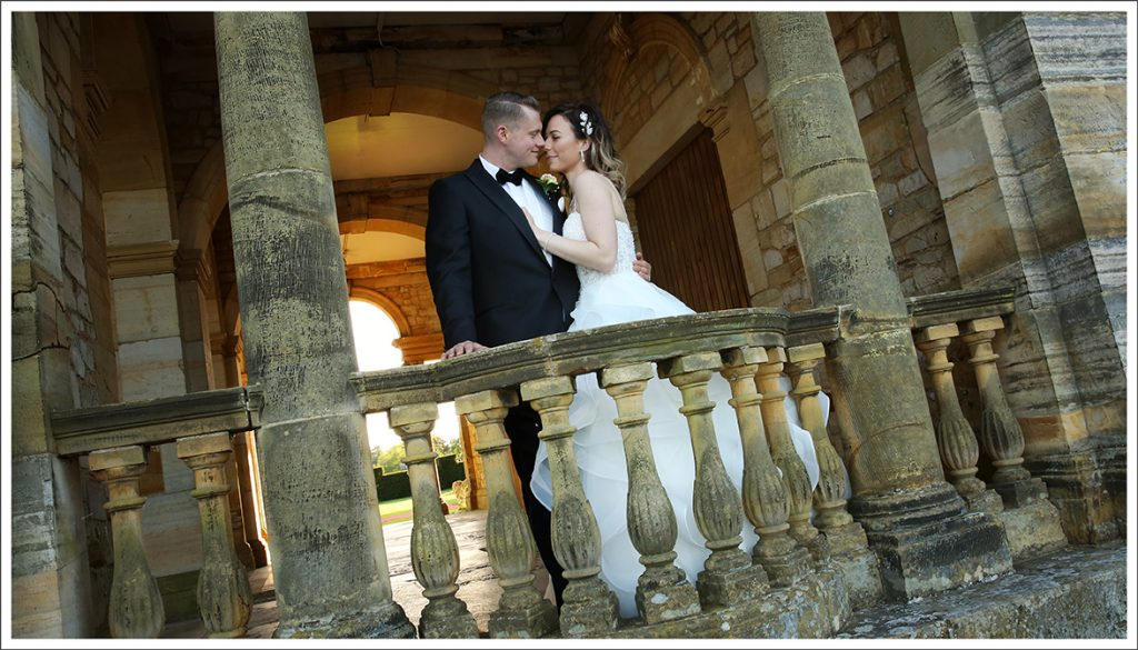 Bride & Groom at lake at Hever Castle