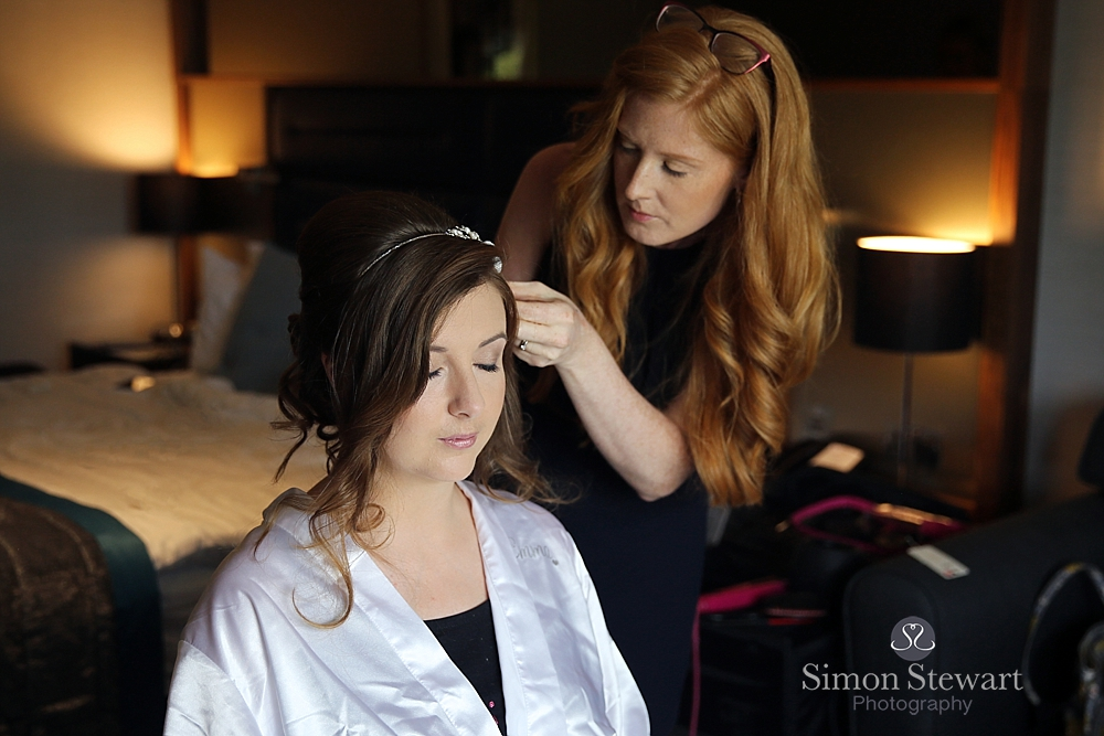 Bride having hair done at Felbridge Hotel