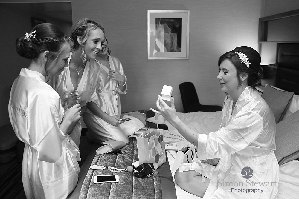 Bride opening a present at the Felbridge Hotel