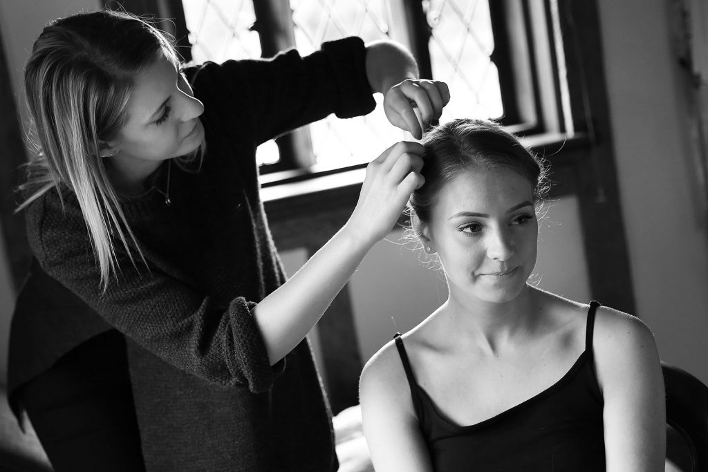 bride having hair done at cain manor, Sussex Wedding Photographers