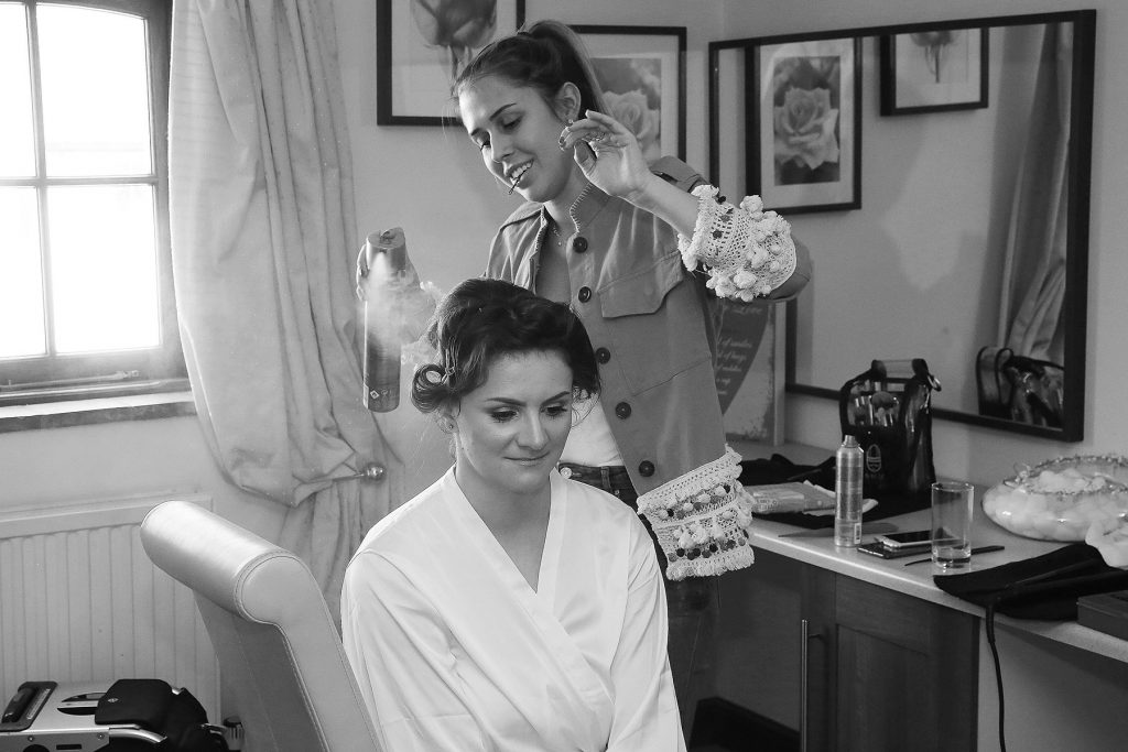 Bride having her done at coltsford Mill in Oxted, Sussex Wedding Photographers