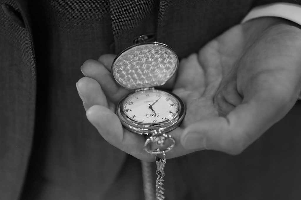 groom checking the time before the arrival of the bride, Sussex Wedding Photographers